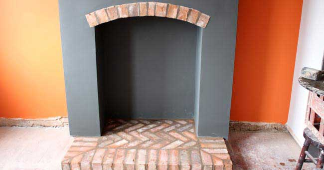 fireplace alteration with brick layed hearth